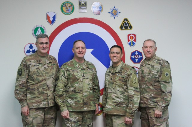 U.S. Army Brig. Gen. Clint E. Walker, 184th Sustainment Command, Lt. Gen. Charles N. Pede, the judge advocate general of the U.S. Army, Command Sgt. Maj. Osvaldo Martinez Jr., TJAG senior enlisted advisor, and Command Sgt. Maj. Jason Little, 184th Sustainment Command, pause for a photo at Camp Arifjan Kuwait, Jan 10, 2019. (U.S. Army National Guard photo by Staff Sgt. Veronica McNabb)