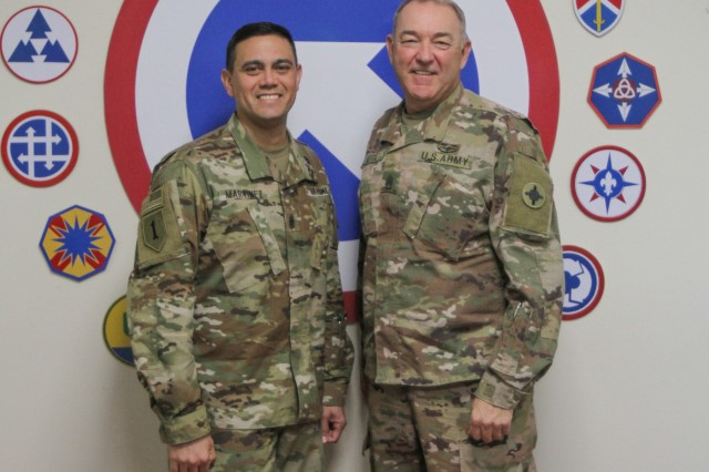 Command Sgt. Maj. Osvaldo Martinez Jr., the U.S. Army's judge advocate general corps' regimental command sergeant major, and Command Sgt. Maj. Jason Little, 184th Sustainment Command, pause for a photo at Camp Arifjan, Kuwait, Jan 10, 2019. (U.S. Army National Guard photo by Staff Sgt. Veronica McNabb)