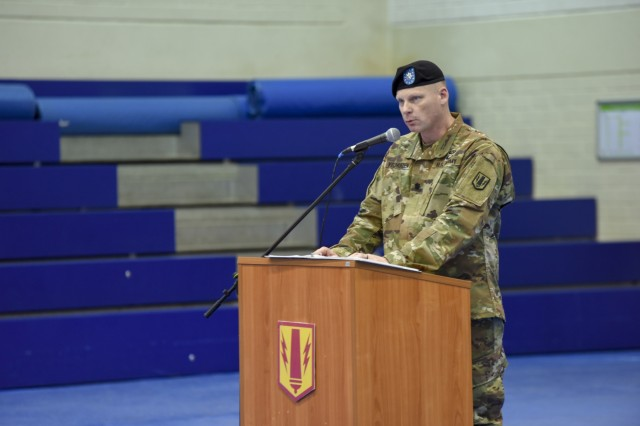 U.S. Army Lt. Col. Ronald A. Velduizen, the new commander of the 589th Brigade Support Batallion, speaks at the unit's reactivation ceremony at the Field House, Jan. 11, 2019, Grafenwoehr, Germany. The 589th BSB is now under the 41st Field Artillery Brigade, the newest unit to join the 7th Army Training Command. (U.S. Army photo by Sgt. Christopher Stewart)