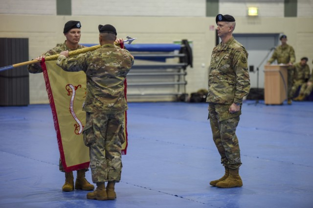 U.S. Army Lt. Col. Ronald A. Velduizen, left, unveils the 589th Brigade Support Battalion colors during the unit's reactivation ceremony at the Grafenwoehr Field House, Jan. 11, 2019, Grafenwoehr, Germany. The ceremony is where he also took command of the unit. (U.S. Army photo by Sgt. Christopher Stewart)
