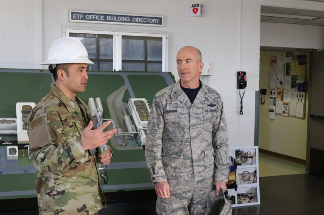 Brig. Gen. Christopher Azzano, commander of the Air Force Test Center, right, is briefed by AEDC Test Systems Sustainment Chief Col. John Tran before his tour of the Engine Test Facility at Arnold Air Force Base. Azzano and other AFTC leadership visited Arnold Air Force Base in mid-November to take part in the 2018 AFTC Strategic Offsite, Azzano's first offsite since assuming the role of AFTC commander in August. (U.S. Air Force photo by Brad Hicks) (This image was altered by obscuring badges for security purposes)