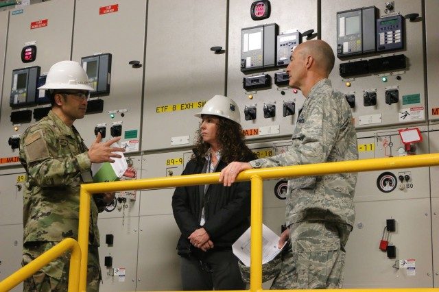 AEDC Test Systems Sustainment Chief Col. John Tran, left, and TSS Capital Improvement Lead Engineer and Service Life Extension Program Manger Kathleen Bajar show Brig. Gen. Christopher Azzano, commander of the Air Force Test Center, the mechanical systems used in the Engine Test Facility at Arnold Air Force Base. Azzano and other AFTC leadership visited Arnold Air Force Base in mid-November to take part in the 2018 AFTC Strategic Offsite, Azzano's first offsite since assuming the role of AFTC commander in August. (U.S. Air Force photo by Brad Hicks) (This image was altered by obscuring badges for security purposes)