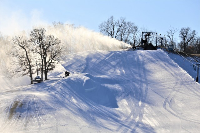 Snow-making machines drop man-made snow on one of the slopes Jan. 9, 2019, at Whitetail Ridge Ski Area at Fort McCoy, Wis. Whitetail Ridge, part of Fort McCoy's Pine View Recreation Area, offers a variety of activities for the whole family. The ski hill offers both downhill skiing and snowboarding. For more information about costs and special events at Whitetail Ridge, visit https://mccoy.armymwr.com. (U.S. Army Photo by Scott T. Sturkol, Public Affairs Office, Fort McCoy, Wis.)