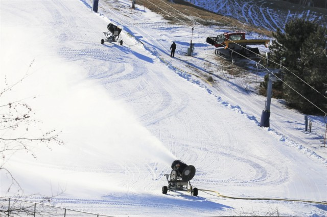 A snow-making machine drops man-made snow on one of the slopes Jan. 9, 2019, at Whitetail Ridge Ski Area at Fort McCoy, Wis. Whitetail Ridge, part of Fort McCoy's Pine View Recreation Area, offers a variety of activities for the whole family. The ski hill offers both downhill skiing and snowboarding. For more information about costs and special events at Whitetail Ridge, visit https://mccoy.armymwr.com. (U.S. Army Photo by Scott T. Sturkol, Public Affairs Office, Fort McCoy, Wis.)