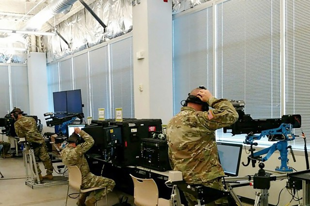 Soldiers prepare to operate training technologies during the STE User Assessment in Orlando, Fla., in March 2018. The assessment was part of an approach implemented by Maj. Gen. Maria R. Gervais to put industry prototypes in Soldiers' hands at the beginning of the capability development process.