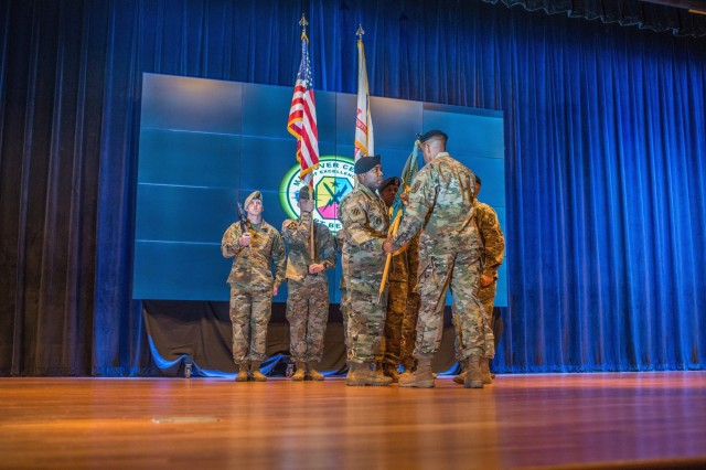FORT BENNING, Ga. (Jan. 14, 2019) - Command Sgt. Maj. Martin S. Celestine receives the Maneuver Center of Excellence and Fort Benning colors from Maj. Gen. Gary M. Brito, the MCoE and Fort Benning commanding general, signifying Celestine's assumption of responsibility. The Maneuver Center of Excellence and Fort Benning gained a new senior enlisted leader at a change of responsibility ceremony Jan. 14 at Marshall Auditorium at Fort Benning, Georgia. Command Sgt. Maj. Martin S. Celestine took responsibility as the MCoE's command sergeant major from his previous position as the command sergeant major of the U.S. Army Infantry School, also at Fort Benning. Command Sgt. Maj. Scott A. Brzak relinquished responsibility to take a position as CSM for G3/5/7 Operations, Plans and Training for the Headquarters of the Department of the Army at the Pentagon in Washington. (U.S. Army photo by Patrick Albright, Maneuver Center of Excellence, Fort Benning Public Affairs)