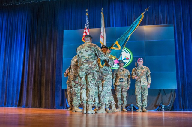 FORT BENNING, Ga. (Jan. 14, 2019) - Command Sgt. Maj. Scott A. Brzak passes the Maneuver Center of Excellence and Fort Benning colors to Maj. Gen. Gary M. Brito, MCoE and Fort Benning commanding general, signifying Brzak's relinquishment of responsibility. The Maneuver Center of Excellence and Fort Benning gained a new senior enlisted leader at a change of responsibility ceremony Jan. 14 at Marshall Auditorium at Fort Benning, Georgia. Command Sgt. Maj. Martin S. Celestine took responsibility as the MCoE's command sergeant major from his previous position as the command sergeant major of the U.S. Army Infantry School, also at Fort Benning. Brzak relinquished responsibility to take a position as CSM for G3/5/7 Operations, Plans and Training for the Headquarters of the Department of the Army at the Pentagon in Washington. (U.S. Army photo by Patrick Albright, Maneuver Center of Excellence, Fort Benning Public Affairs)