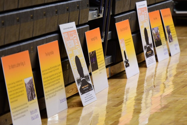 Posters highlighting various facts about Dr. Martin Luther King Jr's life and accomplishments lined the sides of Sadowski Center at Fort Knox's annual Martin Luther King Jr. birthday observance Jan. 11, 2019.