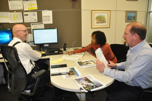Army Materiel Command Resource Management employees, from left, senior technical analyst Steve Mosher, and budget analysts Elle Johnson and John Chverchko review budget reports and tasks. The roles of AMC's Resource Management employees are evolving through the Shape the Fight and Ready Army Civilian initiatives to better support Soldiers.