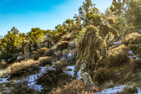 Green Beret snipers, assigned to 10th Special Forces Group (Airborne), sprint at the beginning of a timed event during advanced skills sniper training on Fort Carson, Colo., Dec. 12, 2018.  The purpose behind the training was to test the Soldiers' ability to blend into their environment while still being able to acquire their target without being detected.