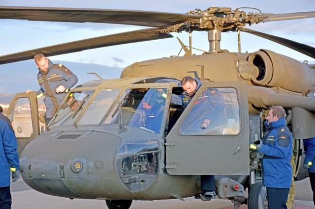 Crew members of the Fregatte Hessen, a German navy ship, get an up-close view of a U.S. Army UH-60 Blackhawk helicopter Dec. 12, 2018 on Clay Kaserne.