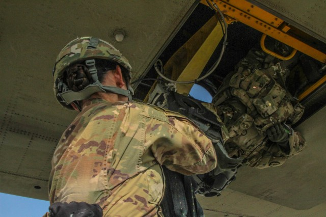 Sgt. Yuri Park, a California native, and finance specialist with the 101st Resolute Support Sustainment Brigade conducts sling load operations in a Bagram, Afghanistan.