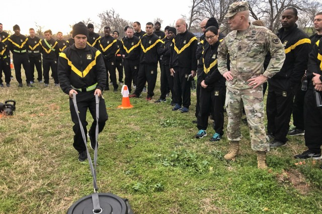 A U.S. Army Reserve Soldier demonstrates an Army Combat Fitness Test event as Lt. Gen. Charles Luckey, chief of the Army Reserve, and commanding general, U.S. Army Reserve Command observes. The ACFT will replace the current fitness test of record by Oct. 2020.
