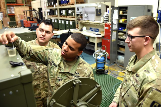 Soldiers use a test strip to check the pH balance of their water source before filling up a field steam sterilizer during training at the U.S. Army Medical Materiel Agency's Medical Maintenance Operations Division in Tobyhanna, Pa.
