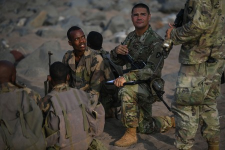 Soldiers with the Texas Army National Guard, deployed in support of Combined Joint Task Force - Horn of Africa (CJTF-HOA), gives instruction on infantry tactics and procedures to Djiboutian soldiers with the Rapid Intervention Battalion (RIB) outside Djibouti City, Djibouti, Dec. 18, 2018.