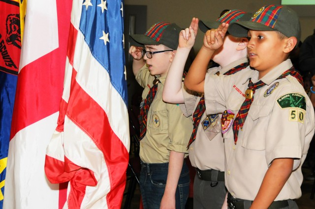 Scouts post the colors at the ceremony.