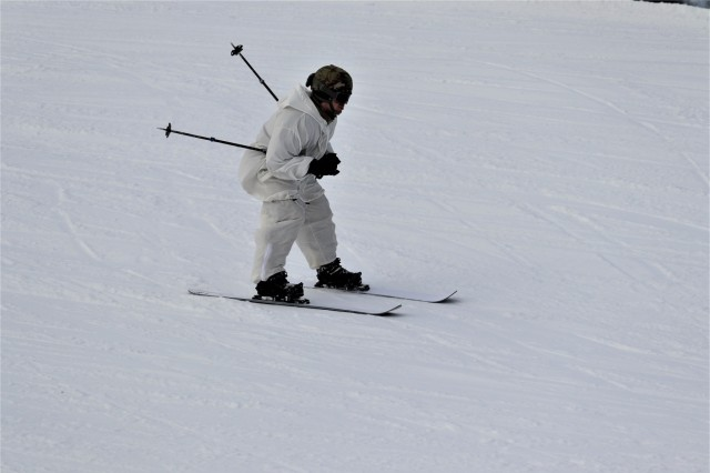 A student in the Fort McCoy Cold-Weather Operations Course (CWOC) Class 19-02 practices skiing Jan. 11, 2019, at Whitetail Ridge Ski Area at Fort McCoy, Wis. In addition to skiing, CWOC students are trained on a variety of cold-weather subjects, including snowshoe training as well as how to use ahkio sleds and other gear. Training also focuses on terrain and weather analysis, risk management, cold-weather clothing, developing winter fighting positions in the field, camouflage and concealment, and numerous other areas that are important to know in order to survive and operate in a cold-weather environment. The training is coordinated through the Directorate of Plans, Training, Mobilization and Security at Fort McCoy. (U.S. Army Photo by Scott T. Sturkol, Public Affairs Office, Fort McCoy, Wis.)