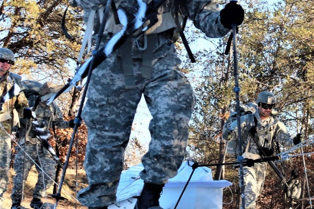 A student in Cold-Weather Operations Course (CWOC) Class 19-02 completes a ruck march while wearing snowshoes and backpacks as well as while pulling ahkio sleds Jan. 9, 2019, at Fort McCoy, Wis. CWOC students are trained on a variety of cold-weather subjects, including snowshoe training and skiing as well as how to use ahkio sleds and other gear. Training also focuses on terrain and weather analysis, risk management, cold-weather clothing, developing winter fighting positions in the field, camouflage and concealment, and numerous other areas that are important to know in order to survive and operate in a cold-weather environment. The training is coordinated through the Directorate of Plans, Training, Mobilization and Security at Fort McCoy. (U.S. Army Photo by Scott T. Sturkol, Public Affairs Office, Fort McCoy, Wis.)