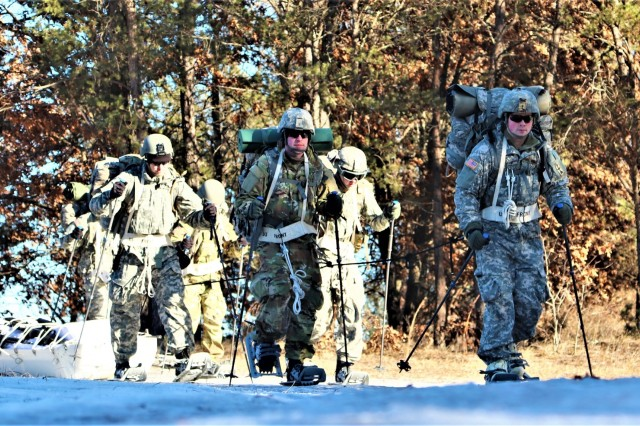 Students in Cold-Weather Operations Course (CWOC) Class 19-02 complete a ruck march while wearing snowshoes and backpacks as well as while pulling ahkio sleds Jan. 9, 2019, at Fort McCoy, Wis. CWOC students are trained on a variety of cold-weather subjects, including snowshoe training and skiing as well as how to use ahkio sleds and other gear. Training also focuses on terrain and weather analysis, risk management, cold-weather clothing, developing winter fighting positions in the field, camouflage and concealment, and numerous other areas that are important to know in order to survive and operate in a cold-weather environment. The training is coordinated through the Directorate of Plans, Training, Mobilization and Security at Fort McCoy. (U.S. Army Photo by Scott T. Sturkol, Public Affairs Office, Fort McCoy, Wis.)