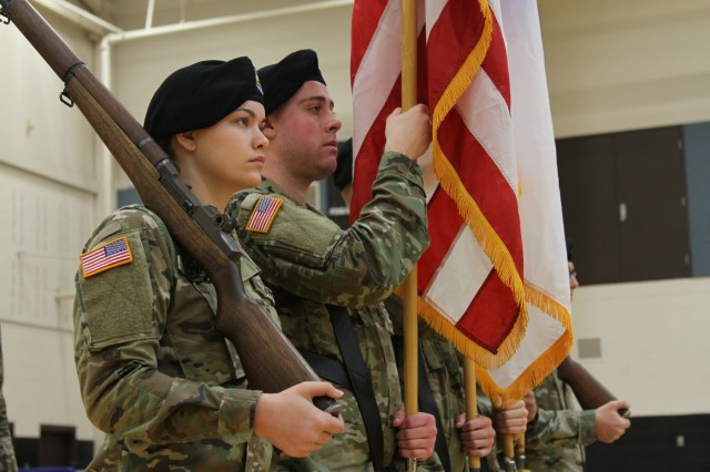 America's First Corps Soldiers stand at attention during an activation ceremony Jan. 11, 2019, at Joint Base Lewis McChord, Washington. The ceremony marked the launch of the first-ever Intelligence, Information, Cyber, Electronic Warfare and Space Detachment in the U.S. Army. I2CEWS was designed to integrate cyber warfare, electronic warfare and space capabilities. (U.S. Army photo by Pvt. Caleb Minor)