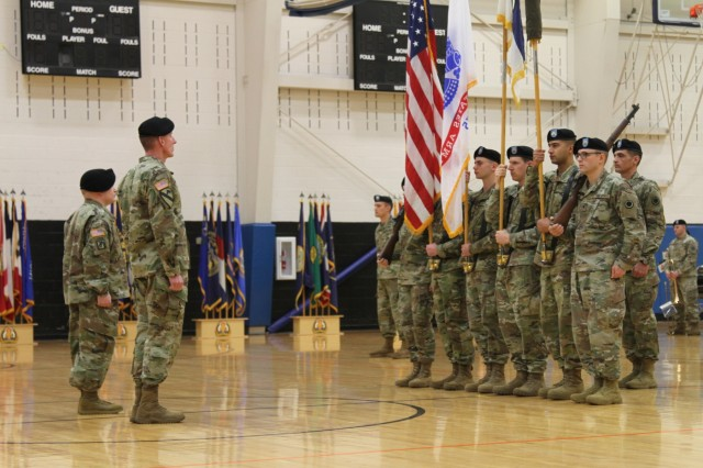America's First Corps Commanding General Lt. Gen. Gary Volesky and Lt. Col. Derek Bothern, battalion commander of the newly activated Intelligence, Information, Cyber, Electronic Warfare and Space Detachment prepare to receive the unit flag for I2CEWS during a ceremony Jan. 11, 2019, at Joint Base Lewis McChord, Washington. The ceremony marked the launch of the first-ever Intelligence, Information, Cyber, Electronic Warfare and Space Detachment in the U.S. Army. I2CEWS was designed to integrate cyber warfare, electronic warfare and space capabilities. (U.S. Army photo by Pvt. Caleb Minor)