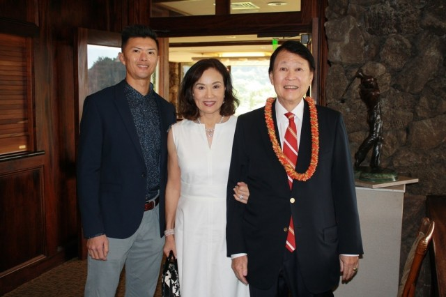 SES Stephen Ban poses for a picture with his wife Sandra and his son Lawrence at his retirement ceremony held at the Oahu Country Club in Honolulu Hawaii on Jan. 15, 2019.