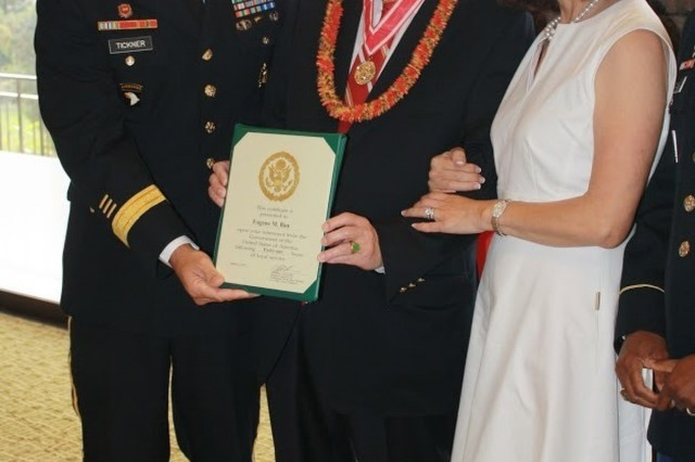 Senior Executive Service Officer Eugene Ban poses for a photo at his retirement ceremony, with his wife and U.S. Army Corp of Engineers (USACE), Pacific Ocean Division (POD) commander Brig. Gen. Thomas Tickner at Oahu Country Club in Honolulu Hawaii on Jan 15., 2019.
