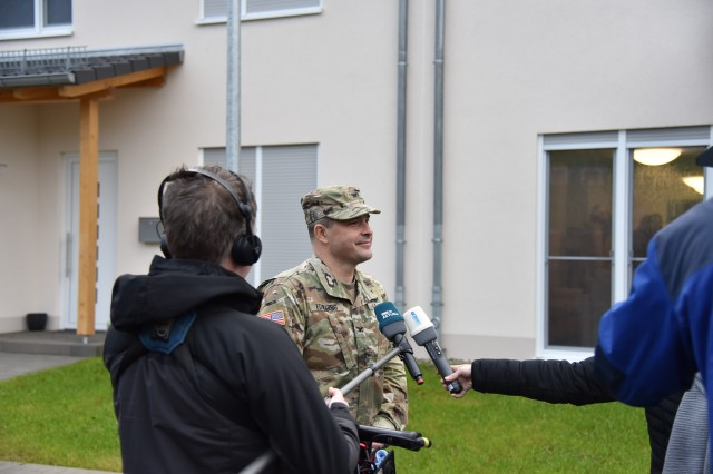 U.S. Army Garrison Rheinland-Pfalz Commander Col. Jason T. Edwards speaks to German media outlets about the completion of 32 new townhouses on Smith Barracks, Baumholder, Jan. 17. These townhouses will be followed by 52 more to be finished later this year.
