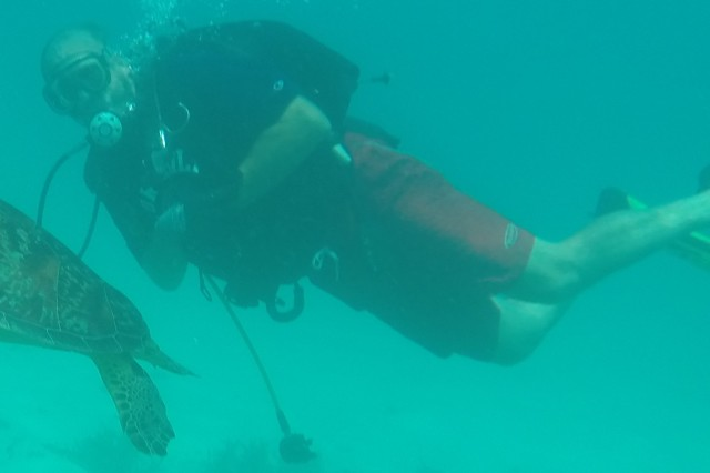 Diver Rick Benoit, North Atlantic Division, picked up a friend while inspecting Echo pier at the US Army Garrison, Kwajalein Atoll in the Marshall Islands.
