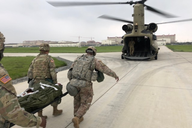 Soldiers from the 1st Armored Brigade Combat Team, 3rd Infantry Division carry a simulated casualty to a CH-47 Chinook for a mass casualty evacuation during the Crusader Shield exercise in Korea on May 14, 2018.