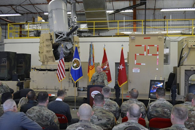 Brig. Gen. Brian Gibson, Air Defense Artillery School commandant and chief of ADA, speaks at the opening ceremony for the new Counter-Rocket Artillery Mortar (C-RAM) classrooms and Virtual Maintenance Trainers at the C-RAM General Instructional Facility here, Dec. 11. The 36 new trainers provide students the same functionality as the actual C-RAM weapon system.