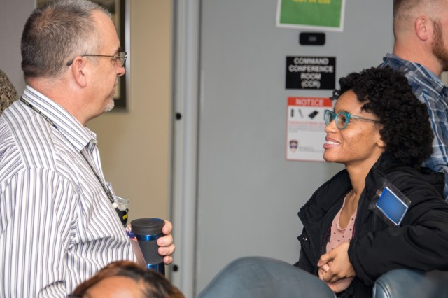 Michael J. Saluto (left) a computer scientist in the Test Technology Directorate of the U.S. Army Operational Test Command, talks with Angelica Jones, a student with Texas A & M Central Texas, who studiers Computer Science there. Both took part in OTC's first Externship with local university college students Jan. 11.
