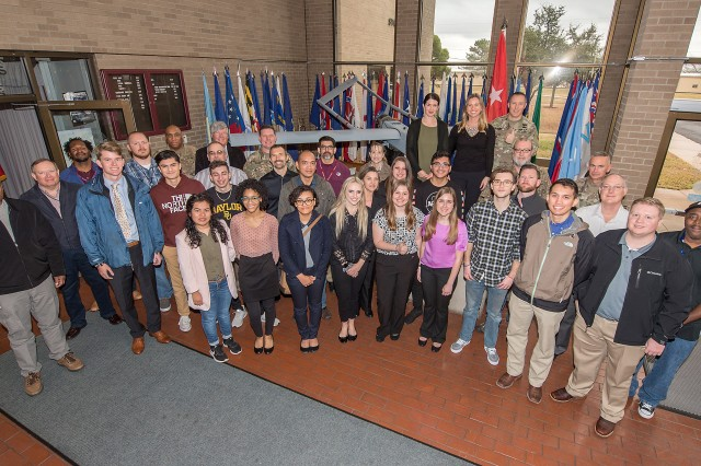 Central Texas area college students stand along with their mentors in the foyer of the U.S. Army Operational Test Command Jan. 11. Nineteen Central Texas area college students connected with U.S. Army Operational Test Command mentors as part of the test unit's Externship.