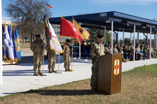 Col. Robert Howe II, the commander of the 1st Medical Brigade, addresses the formation and audience after assuming command of the 1st Medical Brigade at the Change of Command Ceremony on Sadowski Field on Fort Hood, Texas January 17, 2019.