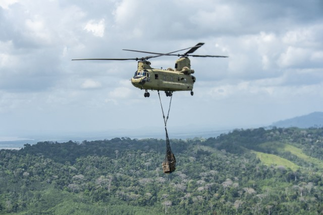A U.S. Army CH-47 Chinook carries supplies to the Darien Province in the Republic of Panama, Jan. 9, 2019. The supplies were for the National Border Service who are building a new outpost in the jungle to stop drug trafficking networks.
