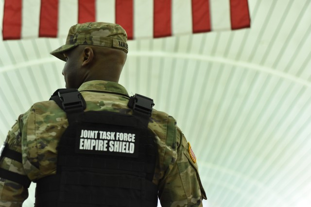 New York Army National Guard Spc Harvey Maseko, stands in Penn Station, Manhattan, N.Y., Jan. 14, 2019. Maseko was patrolling through Penn during a Multi-Agency Super Surge, a mission where multiple law enforcement agencies have a very strong show of Force and work in a Unified, collaborative Effort to share intelligence, best practices, relevant information in a Unified effort to detect, deter and defeat terrorism.