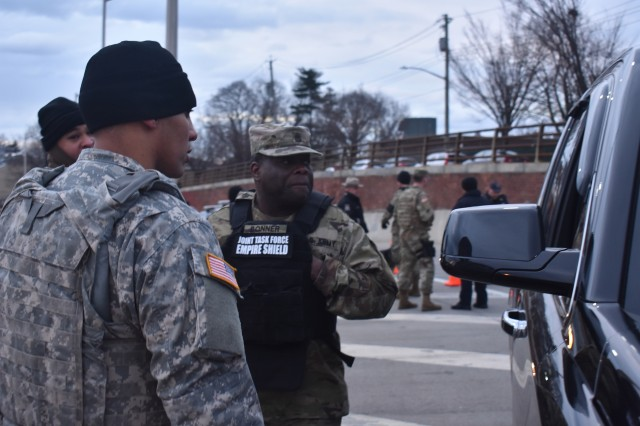New York Army National Guard Spc. Julio Murillo of Delta Company, Joint Task Force Empire Shield(JTFES), inspects a car on the Verrazano bridge, Staten Island, N.Y., Jan 10, 2019. Murillo and other members of the joint task force were supporting local law enforcement officers with Operation Catch-All, checking vehicles coming onto the bridge.