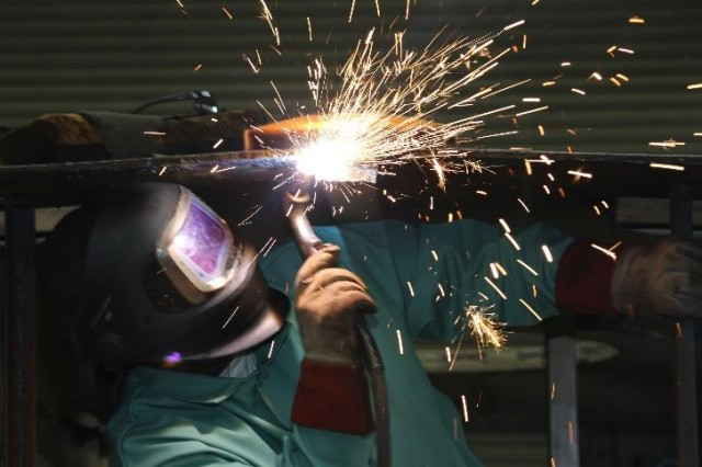A welder at U.S. Army Tank-automotive and Armament Command's Red River Army Depot welds safely while wearing required Personal Protective Equipment.