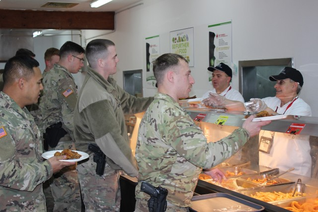 Soldiers line up for lunch at Camp Bondsteel, Kosovo, Jan. 9.  The 405th Army Field Support Brigade provides food and other services through its Logistics Civil Augmentation Program mission at the camp. The 405th AFSB facilitates LOGCAP in Europe and Africa to augment deployed forces and other organizations with sustainment support services. (Photo by Rabia Coombs, 405th AFSB)
