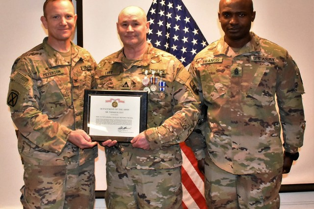 Defense Contract Management Agency (DCMA) Civilian Thomas Luft (right) was awarded the NATO Medal, Global War on Terrorism Medal, Certificate of Wartime Service and Outstanding Civilian Service Award for his service to the Area Support Group-Afghanistan (ASG-A) from May 2018 to January 2019 during a Jan. 11, 2019, ceremony at Bagram Airfield. The awards where presented by ASG-A Commander Col. Jacob Peterson.