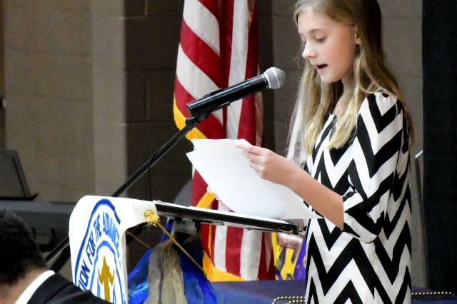 Annabelle Evans, an 11-year-old 6th grader from Scott Middle School at Fort Knox, reads her poem to more than 160 people gathered at the 28th annual Martin Luther King Jr. Unity Celebration Jan. 21. Her poem earned first place in a poetry contest sponsored the Hardin County National Association for the Advancement of Colored People. More than 50 areas students competed for the honor.