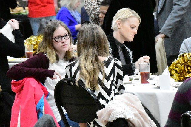 Teagan Petit talks to Annabelle Evans during the Martin Luther King Jr. celebration Jan. 21, 2019, at Grace Heartland Church in Elizabethtown, Kentucky.