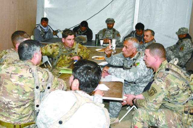 Soldiers with the 2nd Security Force Assistance Brigade speak with role players serving as their counterparts with Afghanistan National Army during an exercise during the 2nd SFAB's rotation to the Joint Readiness Training Center, Jan. 16.