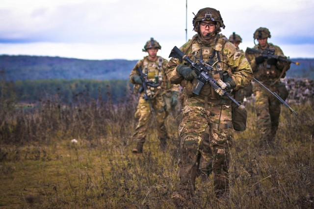 U.S. Army Sgt. Tyler Lutz, a team leader assigned to Alpha Company, 2nd Battalion, 5th Cavalry Regiment, 1st Armored Brigade Combat Team, 1st Cavalry Division, leads a tactical formation on a ridge line during Combined Resolve XI, Hohenfels, Germany, Dec. 4, 2018. Combined Resolve XI at the Joint Multinational Readiness Center is the final exercise in 1-1 CD's rotation in support of Atlantic Resolve in Europe, which evaluates the interoperability of U.S. forces with their NATO allies and partners.