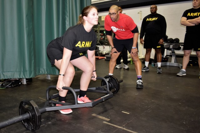 """A U.S. Army Soldier assigned to the 629th Military Intelligence Battalion receives instruction on proper Deadlift technique in preparation of the Army Combat Fitness Test Jan. 14, 2019, at Camp Fretterd Military Reservation in Reisterstown, Md. Over the next six months, about 60 Soldiers from the MI battalion are incorporating a program known as """"Fit to Serve"""" into their military training and civilian life to improve overall mental and physical health."""