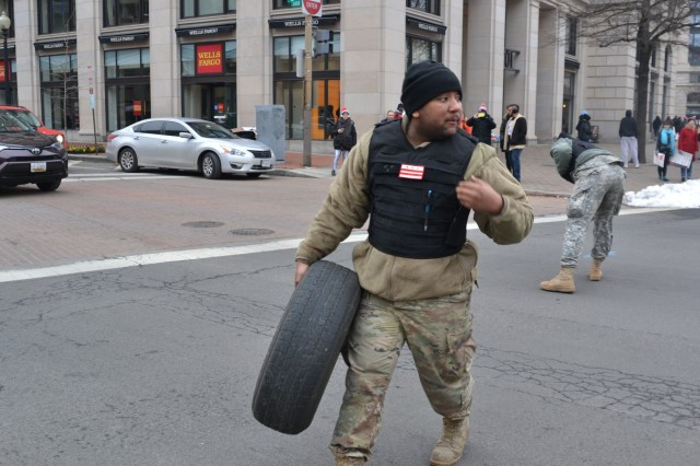 "Pfc. Rafiq Blodgett retrieves a tire from the middle of a busy downtown Washington, D.C. street. The tire fell from the back of a privately owned vehicle. Blodgett, a wheeled vehicle mechanic, 547th Transportation Company, said his job was to manage traffic, ""the tire was in the way."""