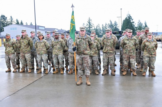Soldiers from the Headquarters and Headquarters Detachment, 504th MP (Military Police) Battalion stand awaiting the presentation of the FORSCOM Military Police Readiness Eagle Award Jan. 9, 2019, at the 504th Battalion Motorpool, Joint Base Lewis-McChord, Washington. The Eagle award bestowed on HHD of 504th MP Bn. was awarded for being the best small MP detachment in FORSCOM, where Headquarters and Headquarters detachments, law and order detachments, or the Military Police working dog detachments are in the running throughout FORSCOM. (U.S. Army photo by Pvt. Laurie Ellen Schubert)