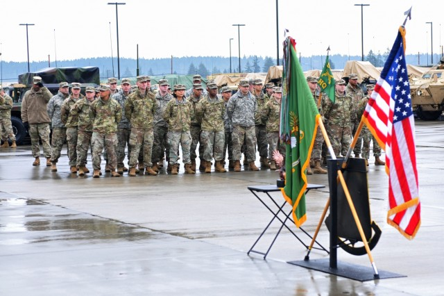 Soldiers from the Headquarters and Headquarters Detachment, 504th MP (Military Police) Battalion stand awaiting the presentation of the FORSCOM Military Police Readiness Eagle Award Jan. 9, 2019, at the 504th Battalion Motorpool, Joint Base Lewis-McChord, Washington. This is the first time HHD, 504th MP Bn. received this award. (U.S. Army photo by Pvt. Laurie Ellen Schubert)