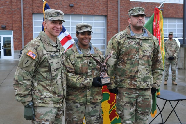 Command Sgt. Maj. Michael Grinston, command sergeant major for U.S. Army Forces Command, presents the soldiers of the Headquarters and Headquarters Detachment, 504th MP (Military Police) Battalion, with the FORSCOM Military Police Readiness Eagle Award Jan. 9, 2019, at the 504th Battalion Motorpool, Joint Base Lewis-McChord, Washington. Capt. Raquel S. Felder and 1st Sgt. Axel H. Castellanos accepted the Eagle award on behalf of HHD. (U.S. Army photo by Pvt. Laurie Ellen Schubert)