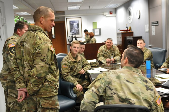 Command Sgt. Maj. Michael Grinston, command sergeant major for U.S. Army Forces Command, drops in on a meeting in America's First Corps Headquarters Jan. 9, 2019, at Joint Base Lewis-McChord, Washington. Grinston greeted many individuals he had worked with as the previous command sergeant major of first corps and many individuals that were new to him as well. (U.S. Army photo by Pvt. Laurie Ellen Schubert)